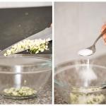 Punem usturoiul într-un castron potrivit ca mărime şi adăugăm o lingură de sare